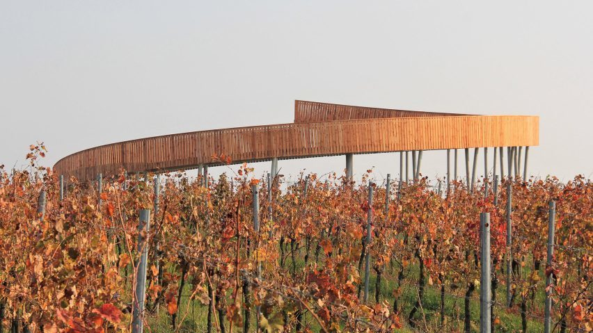 The Walk Above the Vineyards is a circular ramp designed by architecture studio Keeo4design, which offers an elevated view over the vineyards in the Czech Republic's South Moravian Region.