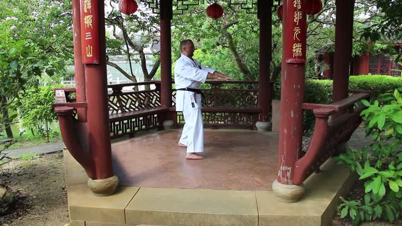 Sensei Aleksandr Grib. Kanryo Higaonna Sanchin kata in the Chinese park in Okinawa, 2019.