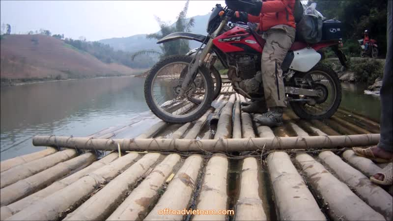 Bamboo rafting on Vietnam motorbike tours by Honda XR250 and XR125L