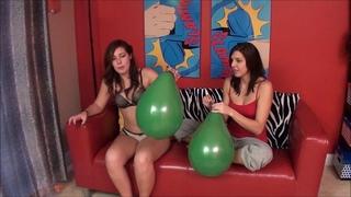 Sadie Holmes popping balloons