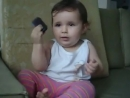 Little girl at the phone