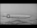 A small airplane in flight drops off airship USS Akron over the west coast of the...HD Stock Footage