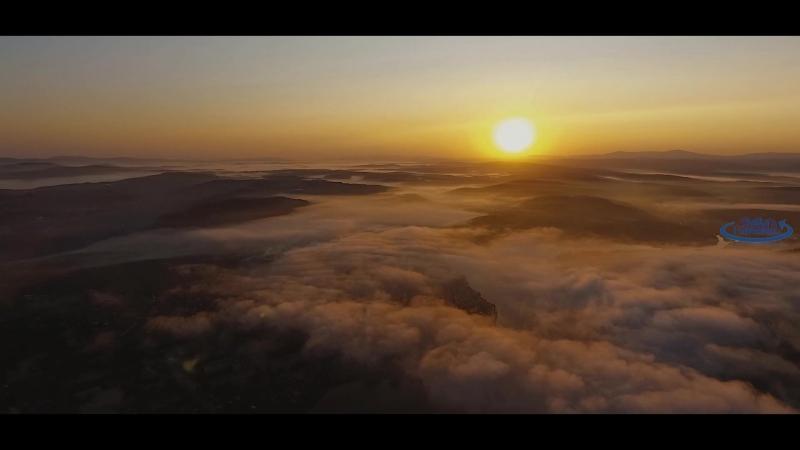Рассвет над облаками
