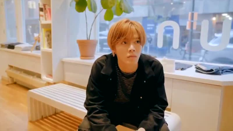 Yuta was sitting waiting for jaehyun trying on clothes lol this is peak boyfriend behaviour yall
